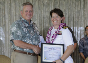 Lt. Cmdr. Robin Taylor receives her Team Excellence award photo